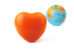 Orange heart and globe for valentine day. Royalty Free Stock Image