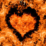 Orange heart shape fire Stock Photography