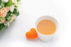Orange heart shape with orange juice and rose on isolated white. Orange heart shape with orange juice and orange rose on isolated white background, valentine day royalty free stock photography