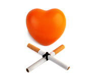Orange heart  and two cigarettes. Stock Photography