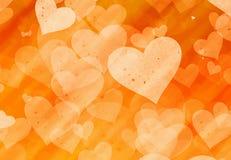 Orange hearts backgrounds of Love symbol. Orange hearts background of Love symbol Royalty Free Stock Photo