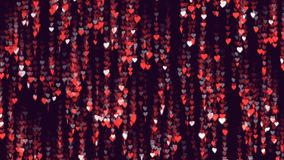 Orange hearts descend leaving a long tail behind them. Confetti of hearts fall spinning. Purple background. Abstract. Background for Valantines Day, Mothers Day stock video