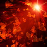 Orange hearts with lights Stock Images