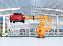 Orange heavyweight robotic arm carrying red SUV in the assembly factory Stock Images