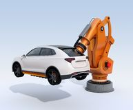 Orange heavyweight robotic arm delivering white SUV on light blue background Royalty Free Stock Image