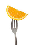 Orange held by a fork Royalty Free Stock Images