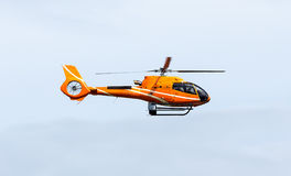 Orange helicopter Stock Photography