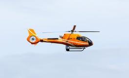 Orange helicopter Stock Photography