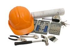 Orange helmet and different tools isolated Stock Photo
