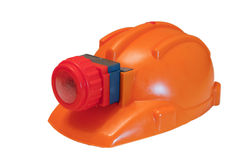 Orange helmet with head lamp Royalty Free Stock Image