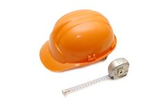 Orange helmet and measuring tape Royalty Free Stock Photo