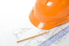 Orange helmet, pencil, ruler and blueprint Stock Photos
