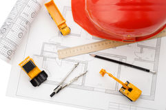 Orange helmet, ruler, pencil, drawing, construction equipment. All that is needed to start construction Stock Photos