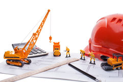 Orange helmet, ruler, pencil, drawing, construction equipment. All that is needed to start construction Stock Photography