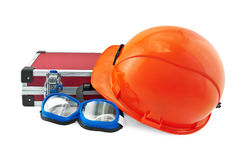 Orange helmet, suitcase and goggle Stock Photo