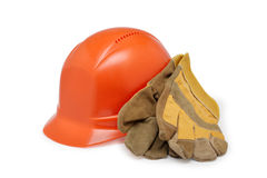 Orange helmet work and protective gloves on a white background Stock Photos