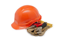 Orange helmet work and protective gloves on a white background Royalty Free Stock Photos