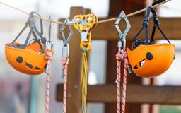 Orange Helmets and Strapping in the rope park. Adult and kids equipment for climbing in the adventure rope park. Active lifestyle royalty free stock images