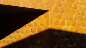 Orange hexagonas i skuggan Arkivbild