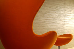 Orange High Back Chair with Footstool Royalty Free Stock Photo