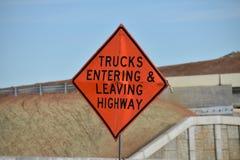 Orange highway construction warning sign royalty free stock images
