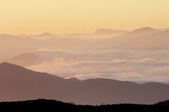 Orange hills. Hills between the mist in the Algairen Mountains; Aragon; Spain Royalty Free Stock Image