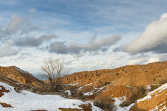 Orange hills in the snow. Kyrgyzstan, witer Stock Image