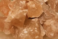 Orange Himalayan salt pieces closeup stock photography