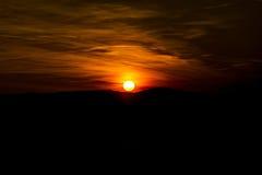 Orange Himmel während des Sonnenuntergangs Lizenzfreie Stockbilder