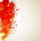 Orange Hintergrund mit Fleck und spritzt ? Lizenzfreies Stockbild