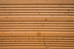 Orange Hintergrund mit Ziegelsteinbeschaffenheit Lizenzfreie Stockfotografie