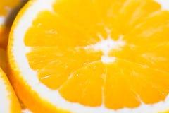 Orange Hintergrund von der Scheibe einer orange Fruchtbeschaffenheit Stockfotos