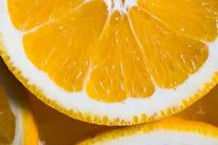 Orange Hintergrund von der Scheibe einer orange Fruchtbeschaffenheit Stockbilder