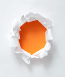 Orange hole in white paper Royalty Free Stock Image