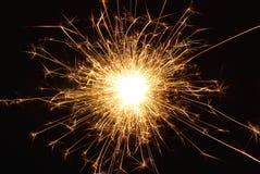 Orange holiday sparkle- fireworks Stock Image
