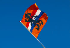 Orange Holland Flag. Against a radiant blue sky Stock Images
