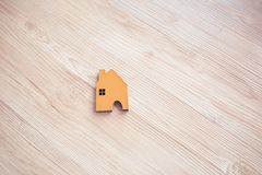 Home shape wood on floor Royalty Free Stock Image