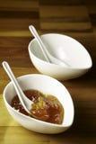 Orange homemade jam in a white ceramic bowl. Still life photo of orange homemade jam in a white ceramic bowl Royalty Free Stock Photo