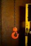 Orange hook and rusty chain Stock Photo
