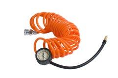 Orange hose with the manometer. Stock Photo