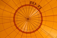 Orange hot air balloon. Low angle view inside an orange hot air balloon Royalty Free Stock Images