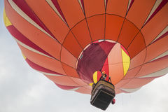 Orange Hot Air Balloon in the sky Royalty Free Stock Images