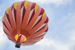 Orange Hot Air Balloon in the sky Royalty Free Stock Photography