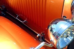Orange Hot Rod. Detail of front end of orange hot rod stock photography