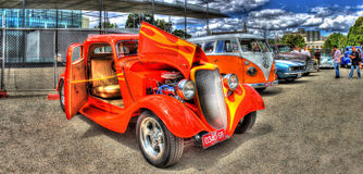 Orange hot rod on display Royalty Free Stock Image