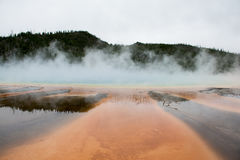 Orange Hot Springs. The Grand Prismatic Springs are one of the most recognizable features at Yellowstone National Park. Most of the time the images that are the Stock Photo
