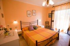 Orange. Hotel bedroom with orange decor Royalty Free Stock Photo