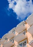 Orange Hotel in front of a blue sky Royalty Free Stock Photo