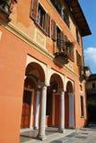 Orange house. Municipal building city hall in Orta San Giulio village, Piedmont, Italy Royalty Free Stock Image