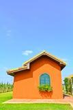 Orange house. In the garden Royalty Free Stock Photos
